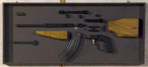 Harold De Bree | Exhibit Cabinet no. 4 | 2010 | Wooden box, disassembled rifle & steel magazine clip | 42x98x5.5cm