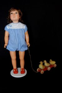Wendy Mayer | Duck Rabbit (Duck) | 2012 | Doll, wax, acrylic eyes, hair, taxidermied ducklings, wooden pull along toy | 78x48x21cm