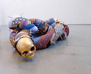 Michal Cole | The Human Condition 1 | 2014 | Ties, foam, metal studs, ceramic, skulls | 100x60x40cm