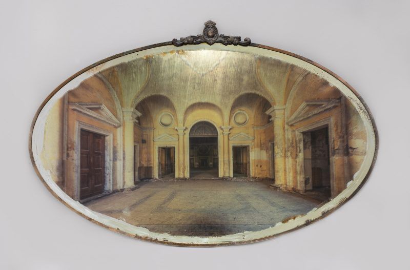 Gina Soden | Asylum Entrance Hall on Mirror | 2018 | Photograph hand printed on antique mirror with 24 carat gold leaf & acrylic seal | 45x69cm