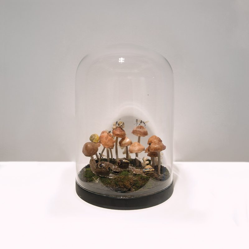 Tessa Farmer | The Race | 2018 | Polymer clay, insects, plant roots, snail shells, bones, earth, moss | 15 (d) x 21 (h)cm