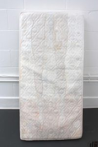 Giulia Lanza   Of the very same fabric mattress 1   2016   Wax, plaster, acrylic, lace texture and embroidery on child mattress   140x75x15cm