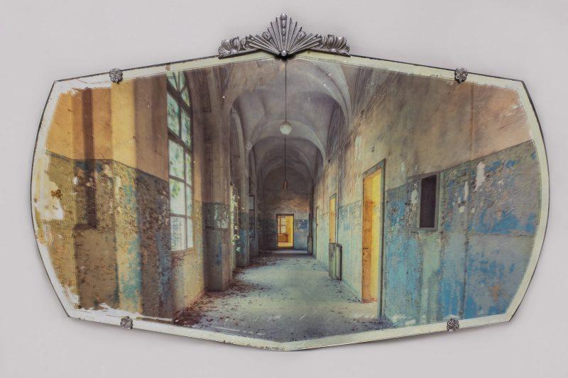 Gina Soden | Asylum Corridor on Mirror | 2018 | Photograph hand printed on antique mirror with acrylic seal | 37x65cm